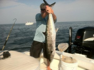 capt-pete-holding-up-a-30lb-king-caught-by-our-clients-that-day 6942306521 o